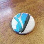 Broken butterfly button by Mattijs van Bergen.